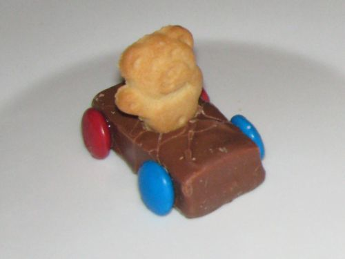 Milky Way Cars - Tiny Teddies.  'glue' wheels (smarties or m) onto mini Milky Ways with melted chocolate. Press Tiny Teddy into the bar