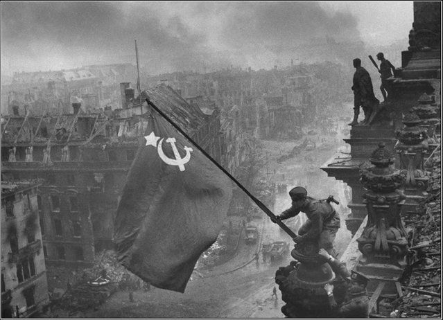 Raising a flag over the Reichstag is a historic World War II photograph taken during the Battle of Berlin on 2 May 1945, by Yevgeny Khaldei