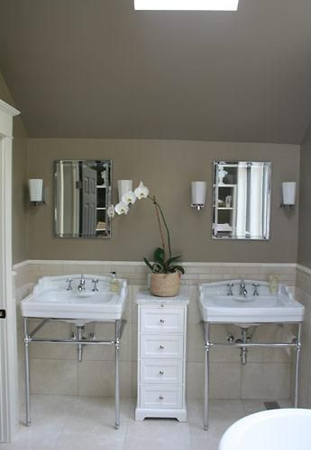 bathrooms - white porcelain sinks polished chrome faucets sconces beveled mirrors white cabinets marble tiles floors backsplash skylight taupe walls paint color bathroom