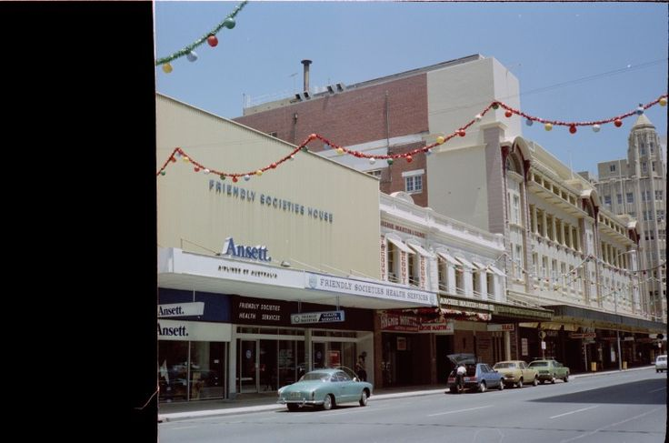 311673PD: Friendly Societies House, Archie Martins store, small shops south to Hay Street, 92-96 William Street, Perth, March 1982 (Click to Start Zoom)