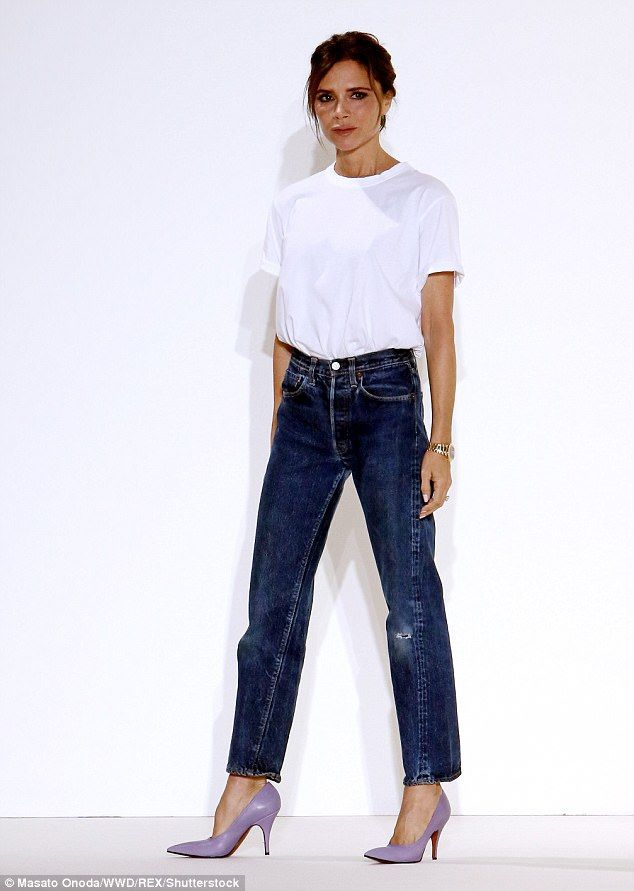 Woman of the hour: Victoria looked chic in boyfriend jeans and a white T-shirt as she greeted the audience at her SS18 collection unveiling on Sunday