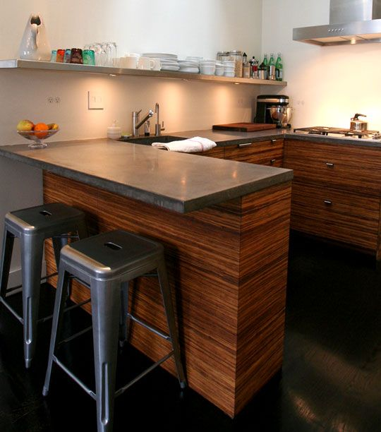 They used plyboo custom made fronts for their IKEA cabinets  They kept the original oak wood flooring  but dyed and stained it black  And they used stainless steel which is easily recyclable or reusable for the open shelving