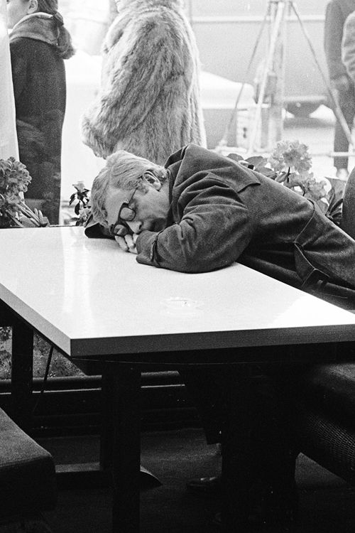 Michael Caine sleeping in Cafe, photographed by Terry O'Neill, 1965.