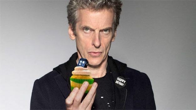 The 12th Doctor with a T.A.R.D.I.S. cupcake  (Doctor Who - BBC Series)  source: http://www.geek.com/wp-content/uploads/2017/04/capaldi-BBC-625x352.jpg
