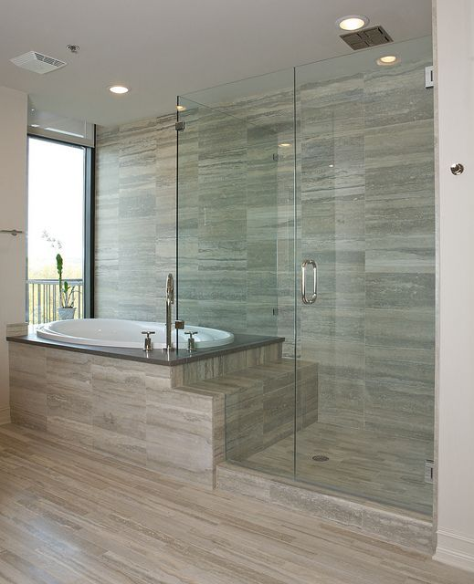 Gorgeous glass shower and garden tub. Could maybe use another (folding) step