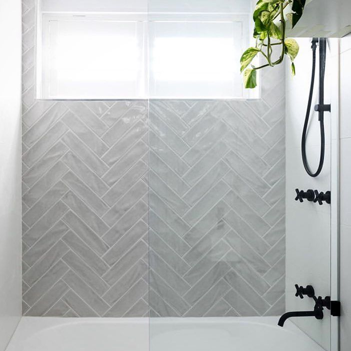National Tiles On Instagram Wonderfully Wavy Whoosh Love This Feature Shower Wall From On Bathroom Feature Wall Bathroom Feature Wall Tile Gray Shower Tile