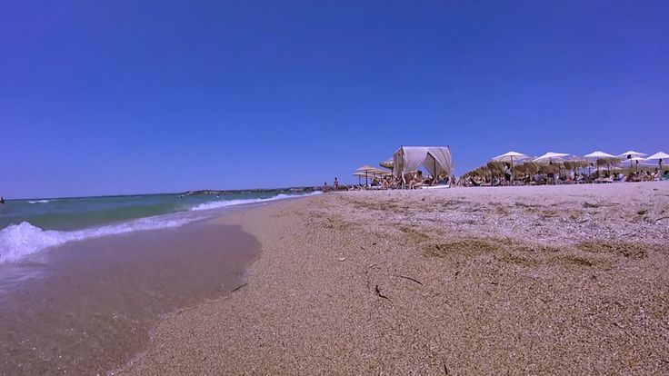The sandy beach bars of Halkidiki, Greece. Nea Irakleia. Apart from Crystal Life and Sahara beach bars In Nea Irakleia you can enjoy the sun at α number of smaller but equally promising beach bars.  For more travel news & videos like us on  https://www.facebook.com/bestravelvideo or  follow https://twitter.com/btrvid.  #sahararesort #χαλκιδικη #chalkidiki #beach #kassandra #beachbar #visitgreece #gopro #greece #griechenland #greece2015 #greecesummer #beaches #халкидики #греция