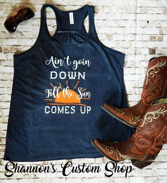 Garth Brooks.  Country lyrics t-shirt.  Ain't going down till the sun comes up.  Check out this item in my Etsy shop https://www.etsy.com/listing/527688985/aint-going-down-till-the-sun-comes-up