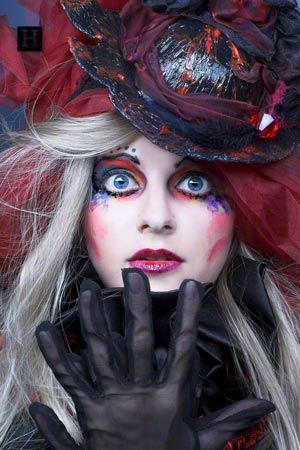 I don;t know what to do for Halloween..maybe some cool make up like this with some ripped up scary clothes...