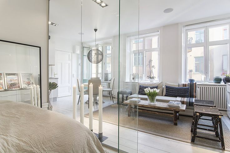 Apartments:Captivating Small Scandinavian Apartment Design With Glass Walls In Bedroom With Living Room Sets With Pillar Candles Sofa Also Bench Carpet Also Dining Sets And Pendant Lighting With White Interior Cozy and Elegant Scandinavian Apartment Design Decorating: Small Apartment in Stockholm