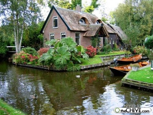 Giethoorn, Holland.  This is just what I picture Holland to be like...with tulips.