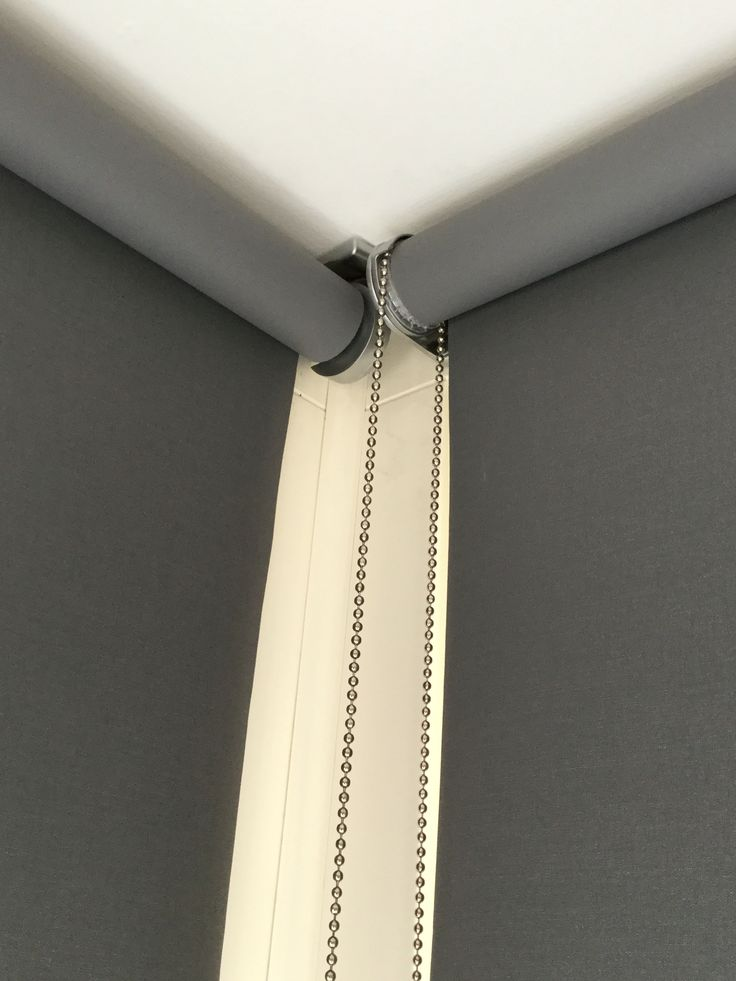 Grey roller blinds get a designer look with these chrome brackets. #designerblinds