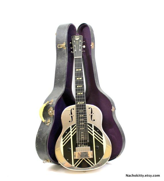 1930s Rare National Silvo Lap Steel Guitar Vintage by Nachokitty Offering a rare 1930s National Silvo Lap Steel Guitar. Vintage Electric guitar. Introduced in 1937 and discontinued in 1942. This model was produced in 1939. Very hard to find musical instrument. In exceptional condition. Sounds beautiful.
