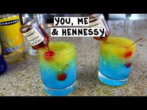 "YOU, ME AND HENNESSY 1 oz (30 ml) Green Apple Vodka 1 oz (30 ml) Creme de Banana Splash Blue Curaçao Crushed Ice Cherries Mango Nectar Mini ""Nip"" Henny Bottle PREPARATION 1. In a glass, pour green apple vodka and Creme de Banana. 2. Add a splash of Blue Curaçao and fill with crushed ice. 3. Top with mango nectar. 4. Drop in cherries and insert a mini bottle of Hennessy. DRINK RESPONSIBLY!"