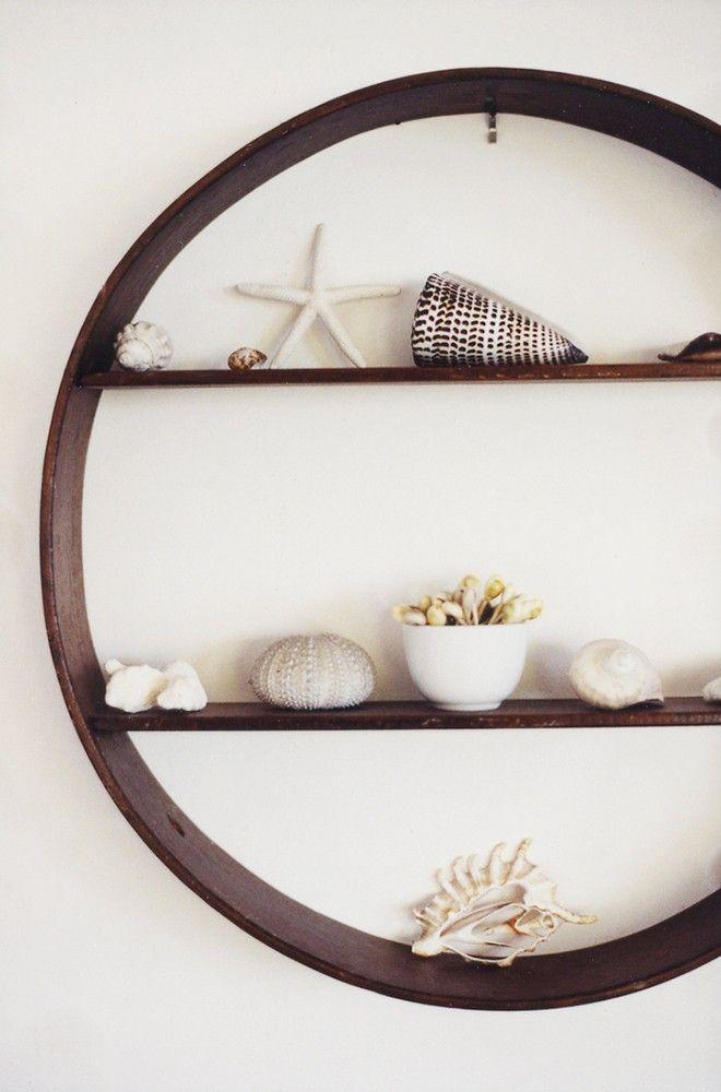cute idea for a shelf - almost like a porthole! Beach house shelves.