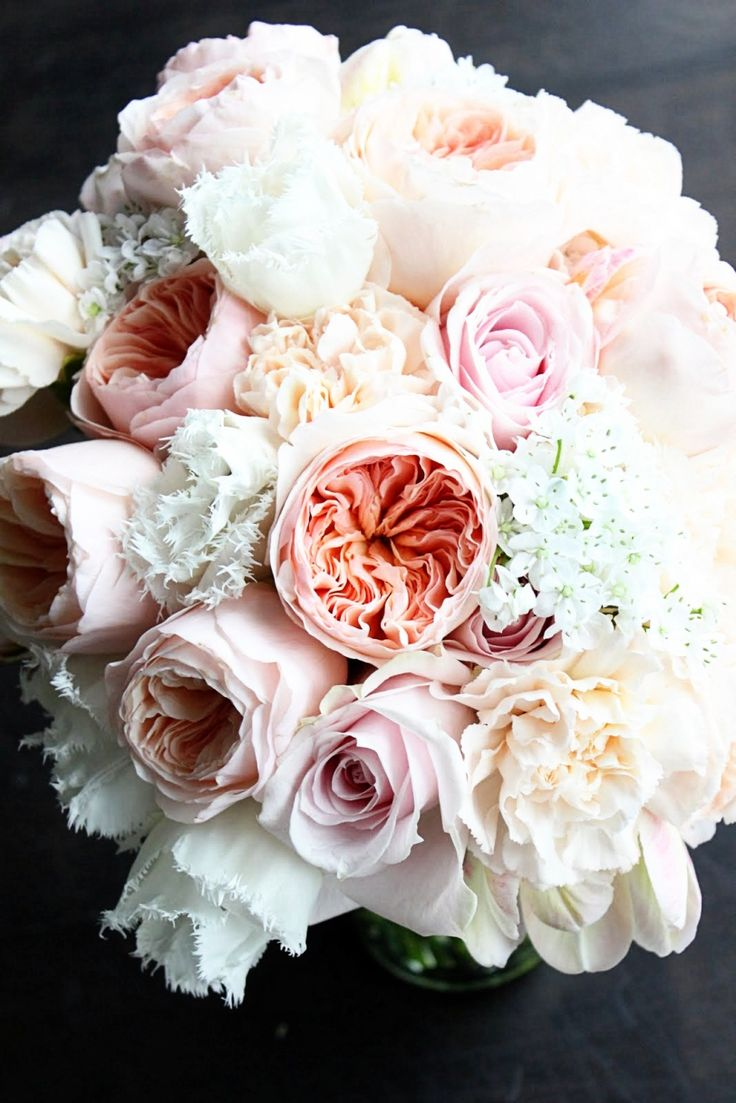 Even the names of these flowers sound romantic; Juliet Garden Roses, White Fringed Tulips and Sweet Avalanche Roses.