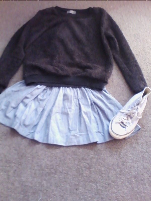 Cute denim skirt with fluffy black mirrou jacket and purple converses.