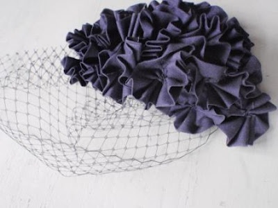 DIY 1940s fascinator - use those old shoulder pads! I would use felt flowers, something shiny to add a little punch...great to make for the Vintage 40s Auction.