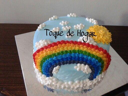 Rainbow cake with whipped cream