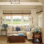 Without the pops of cobalt blue, this smart seating area's neutral tones would feel a little washed out. Fun patterned pillows with drapery and flowers to match don't take the focus off the main event, the wraparound water view from the windows.: Old Trunks, Idea, Living Rooms, Cobalt Blue, Cottages Rooms, Window Treatments, Coastal Living, Small Spaces, Neutral Tones