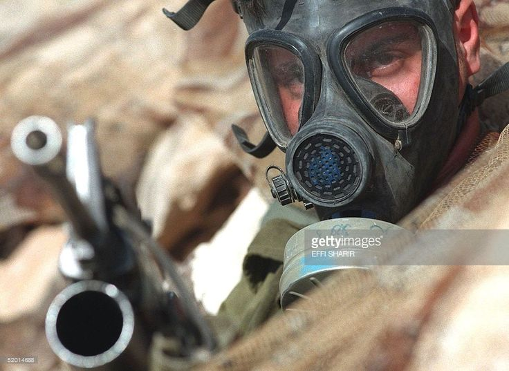 An Israeli soldier wears a gas mask during a biological and chemical warfare drill, as part of annual maneuvers of the Golani Brigade held in the Judean desert outside Jerusalem, 05 February. The Golani soldiers spend much of their three-year compulsory service in south Lebanon.
