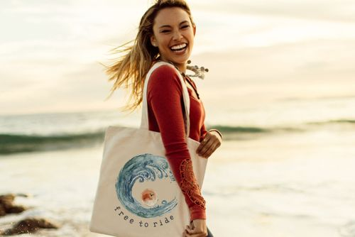 Kiana Wave by The Tote Project Handmade by rescued victims of trafficking in a fair trade certified factory in India. 100% organic cotton canvas printed with water-based, eco-friendly ink