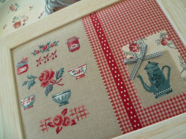 This site is filled with beautiful ideas which combine cross stitch pieces with fabric and trims.