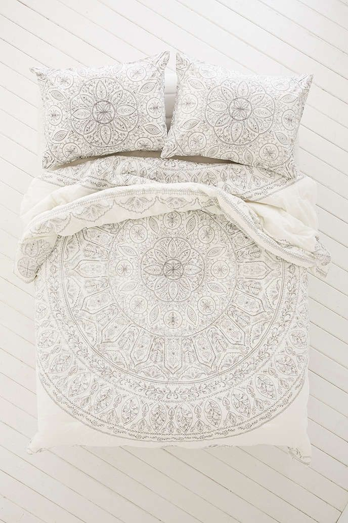 This or similar comforter. White, off white or cream colored, with or without a light colored print. Nothing too busy or bright.
