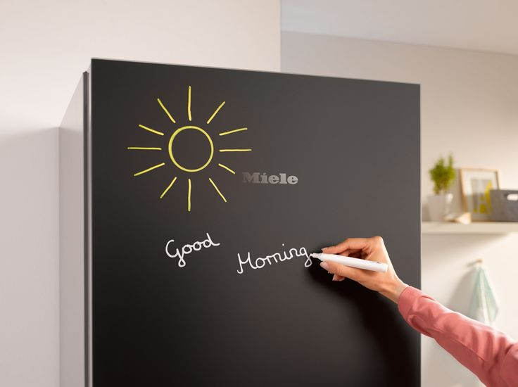 Ideal for shopping lists, notes or simply a fun space for smaller children to get creative with chalk, the Miele KFN29233 D bb Blackboard fridge freezer is perfect for family kitchens #kitchendesign