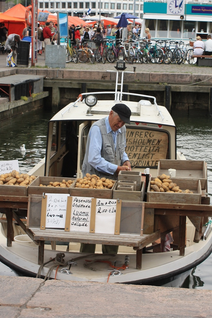 Fisher men selling fish & new potatotes in the Helsinki harbour