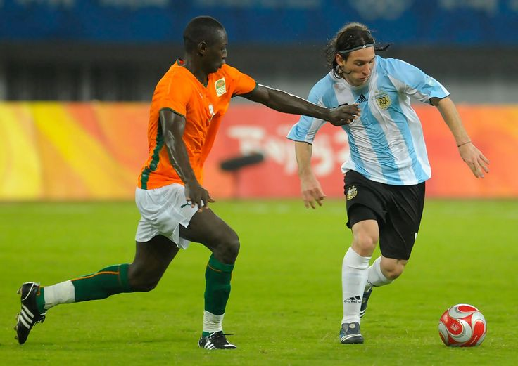 Lionel Messi of Argentina (R) is challenged for the ball by Ousmane Viera Diarrassouba of Ivory Coast during Men's Group A match between Ivory Coast and Argentina on Day -1 of the Beijing 2008 Olympic Games on August 7, 2008 in Shanghai, China.