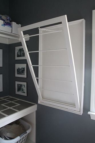 love this for the laundry room! I have saw them on the ceiling for hanging. Must have!