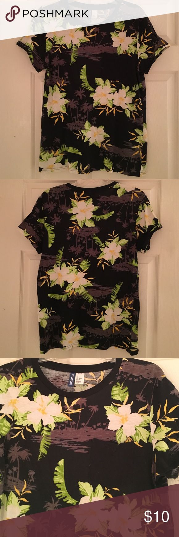 Tropical Hawaiian Tee Black Tee with white hibiscus flowers & grey palm trees. Cuffed sleeve detail & solid black pocket. Technically a men's small, but fits like women's medium. Worn once for a luau! Like-new condition! H&M Tops Tees - Short Sleeve