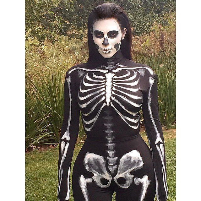 Kim Kardashian showed off her curves in a black leotard when she dressed up as a corpse in 2014.