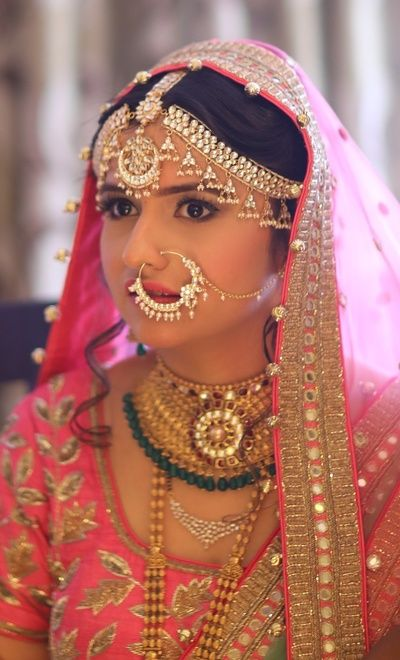 Indian Wedding Jewelry - Silver and Kundan Matha Patti with Maang Tikka | WedMeGood | Gold Necklace and Pink Net Dupatta Veil, Silver Nath  #wedmegood #indianbride #indianwedding #jewelry #indianjewelry #polki #gold #nath #emeralds