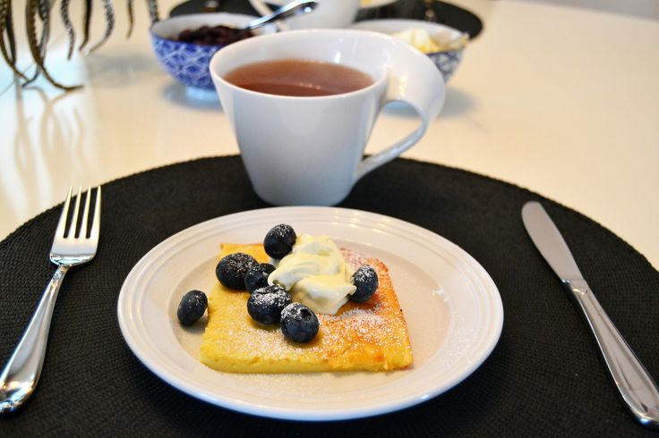 Lemon pancakes with blueberries and sour cream