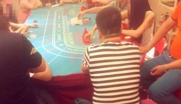 Illegal gambling den where poker players can lose millions exposed by undercover reporter in Beijing