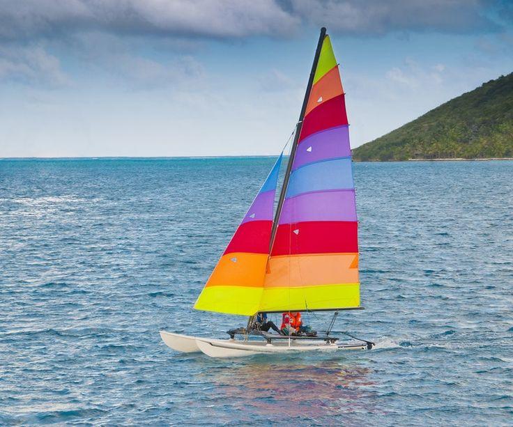 Sail away in color! rainbow boat Catamaran