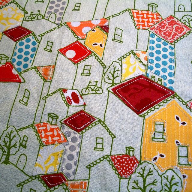 Love this. The house outlines are part of the fabric, the roofs etc were stitched on after. So cute.