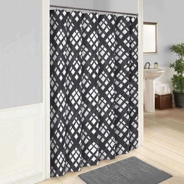 High fashion design meets imaginative and spontaneous style with the Shower Curtain. This trendy shower curtain features a diagonal plaid in charcoal with a textured aesthetic. 12 button holes allow for easy hanging with shower hooks or rings. Pair this curtain with a plastic shower liner to get the most protection and performance.