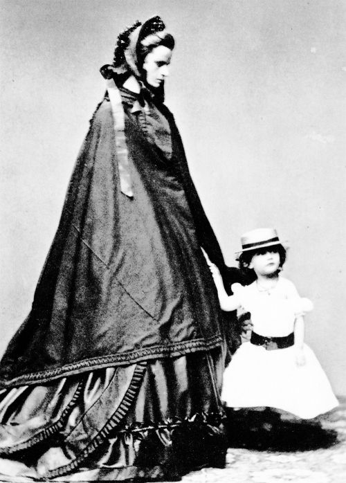 Hereditary Princess Helene Caroline Therese of Thurn und Taxis, née Duchess in Bavaria (4 April 1834 – 16 May 1890) and her daughter HSH Princess Elisabeth Maria Maximiliana of Thurn und Taxis (28 May 1860, Dresden, Kingdom of Saxony – 7 February 1881, Ödenburg, Austrian Empire). Elisabeth married Miguel, Duke of Braganza, only son and second eldest child of Miguel I of Portugal and his wife Adelaide of Löwenstein-Wertheim-Rosenberg in 1877. They had three children: M...