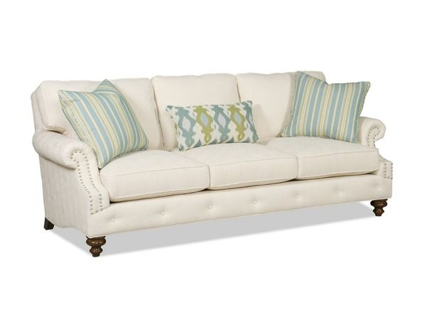 Annabella - This sofa features blendown seat cushions and stylish pillows for added comfort. The enticing nailhead trim and buttons along the front rail...