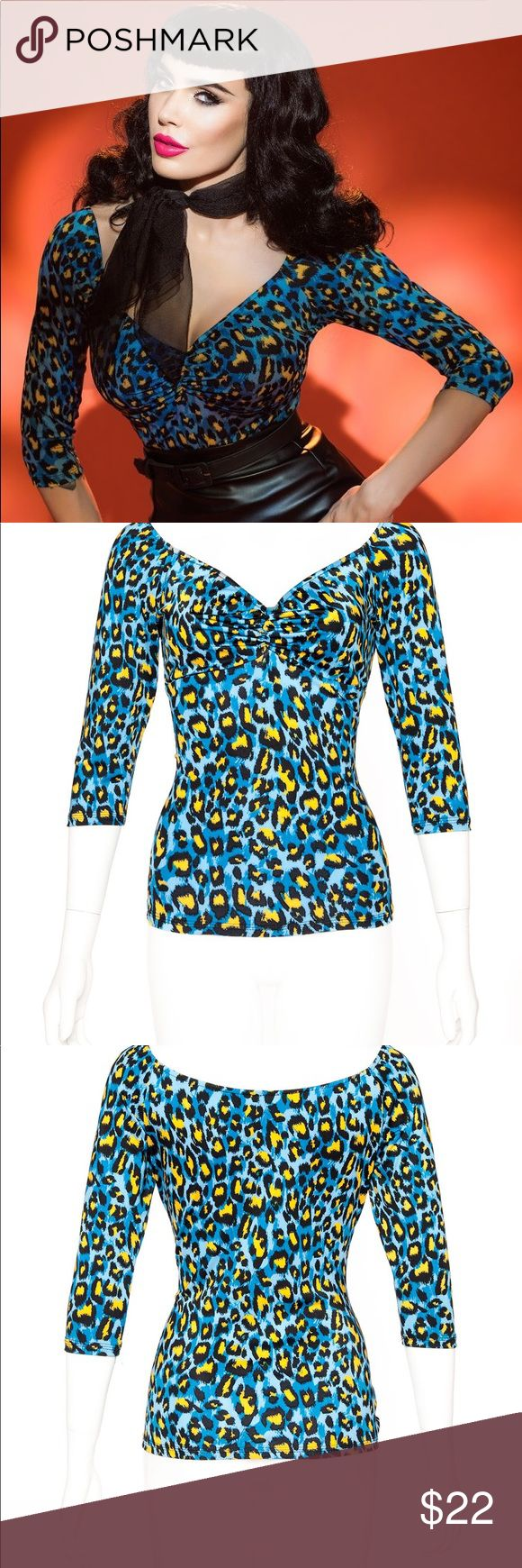 Pinup Girl Clothing Jailbird Top Blue Leopard This listing is for the rare--out of stock--jailbird top in blue 80s print from Pinup Girl Clothing. It is brand new without tags--never worn! Size xs, but has lots of stretch and can fit a small as well! Pinup girl clothing Tops