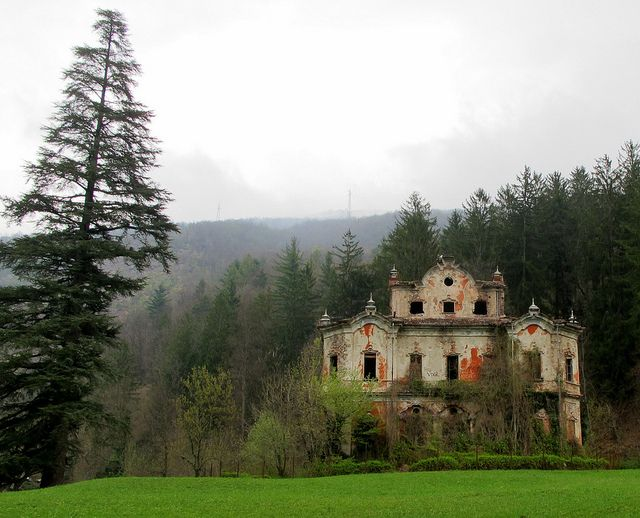 """Located in the mountains east of Lake Como in Italy, this wonderful abandoned Baroque mansion is known locally as """"Villa de Vecchi"""", or the Ghost Mansion. The building has been derelict for years and according to urban legend, was the scene of a murder or suicide. While an effort is underway to save and restore the abandoned mansion, it's future remains uncertain."""