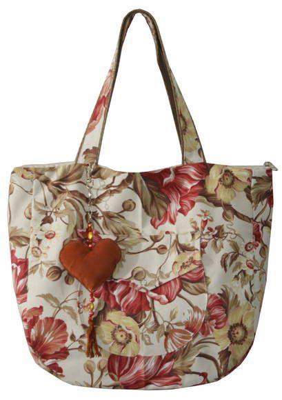 Linda bolsa em lona floral. Ideal para passeio tanto no  shopping quanto na…