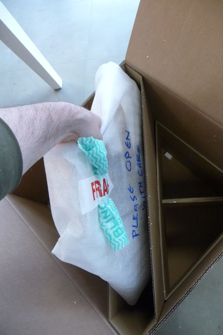 We then carefully lower in the mirror and ensure it rests firmly in the box.