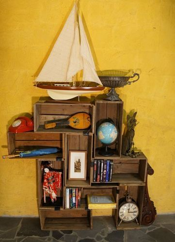 Shelving idea for pirate bedroom. Use crates from Michaels, stain and build!