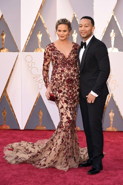#chrissyteigen We think Chrissy Teigen looked wonderful in this long sleeve evening gown on the red carpet at the #Oscars 2016.  The v neck line and beaded art work were lovely.  Our firm is located near Dallas Texas USA and can recreate this couture look for less for you no matter where you live.  Get pricing on any couture #eveningdresses by going to http://www.dariuscordell.com/featured_item/replica-wedding-dresses-reproduction-bridal-gowns/