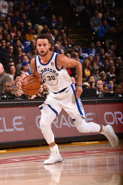 Stephen Curry of the Golden State Warriors handles the ball against the Chicago Bulls on November 24 2017 at ORACLE Arena in Oakland California NOTE...