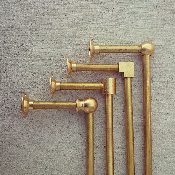 Solid brass pipe towel bar. This can easily be wall mounted or under an existing shelf to hang towels, pots, pans and so much more. The brass has